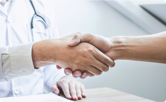 Shaking hands with medical employee.