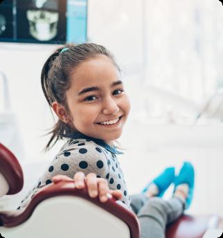 Girl smiling at dentist.