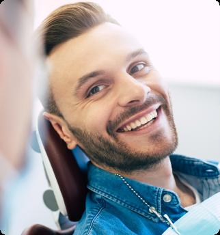 Man smiling at dentist.